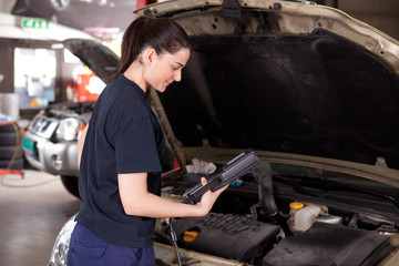 Woman Mechanic with Diagnostics Tool