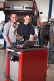 Female Mechanic with Male Customer