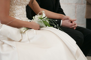 Detail of a bride and groom holding hands