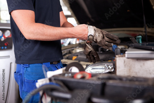 Mechanic Putting on Work Gloves