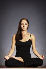 Woman in lotus posture (Padmasana)
