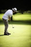 Male golfer putting