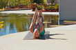 woman doing yoga outdoors in fish pose