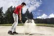 Golfer in sand trap.