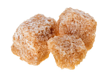 Three brown lump cane sugar cubes, isolated on white