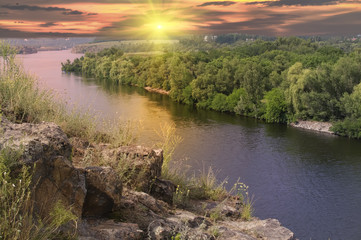 Landscape with rock and river on sunset background