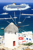 huge cruise ship and a windmill in mykonos