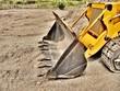 Excavadora topadora, cuchara.