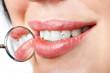 Leinwandbild Motiv dental mouth mirror near healthy white woman teeth