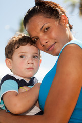 Pretty hispanic woman with baby boy