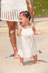 Cute baby girl outdoors in a water park