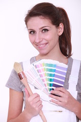 Woman painter with color chart