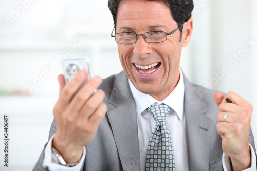 Businessman on the phone laughing