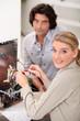 female technician repairing television