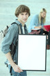 Student holding white board