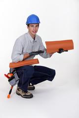 craftsman holding tiles