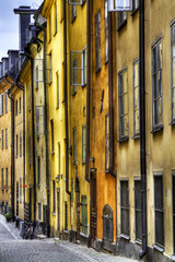 Old facades on a narrow alley in Stockholm Old Town.