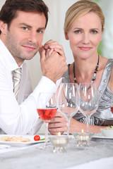 man and woman enjoying a good meal