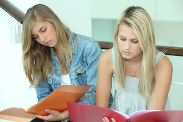 Two female students with folders