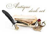 Antique desk set and books  on a white background.