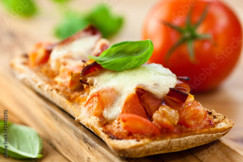 Crostini with tomato,mozzarella and pancetta