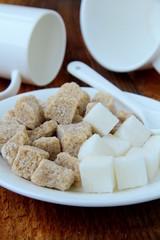 Several types of sugar - refined sugar, brown sugar