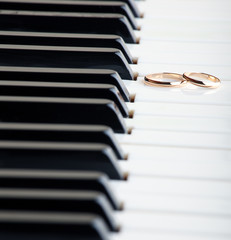 Wedding rings on a piano