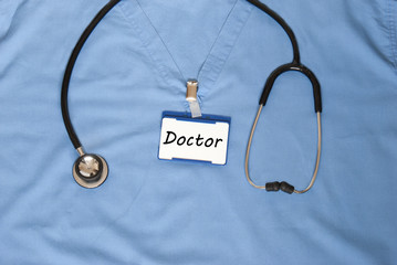 Scrubs of a doctor with a doctors name badge