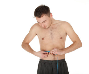 young shirtless man measuring himself