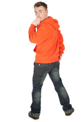 frightened young man in orange sweatshirt, full length, series