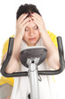 tired fat woman on stationary fitness bicycle, series