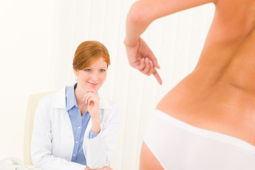 Plastic surgery consultation patient point hips