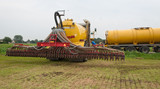 The tank of the manure injector is being filled
