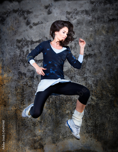 Dancing woman, jumping up.
