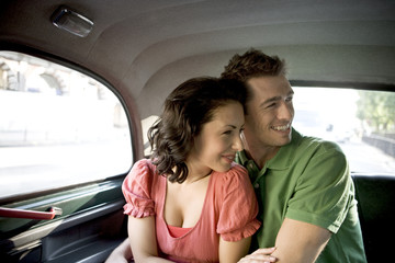 A young couple in a London taxi