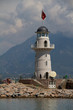Lighthouse in port. Turkey, Alanya. Sunny weather