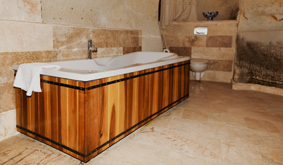wood panel bathroon setting centre taps