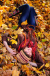 Girl lying in leaves.