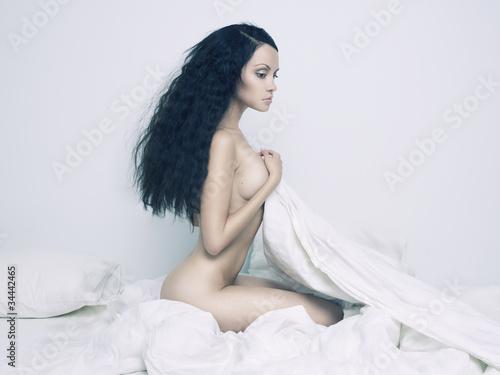 Leinwanddruck Bild Nude elegant woman in bed