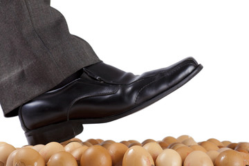 Man walking on egg shells, white background