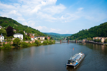 Tourist boat on Neckar river in Heidelberg
