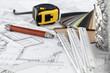 plastics,  metric folding ruler, tape measure, pencil & plan