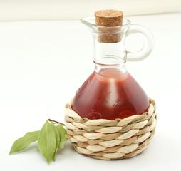 vinegar bottle and laurel leaf