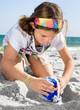 Child Building Sandcastle on a Beach