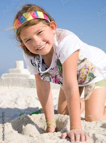 Child Building Sandcastle on a Beach