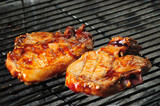 Barbecue pork chops on a charcoal grill