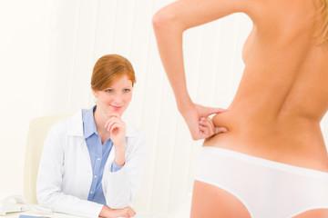 Plastic surgery consultation patient pinch hips