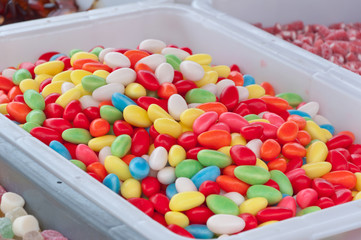 Closeup of brightly colored candies in a stall at a fair