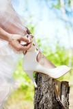 bride lacing white shoes