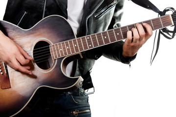 Guitarist playing on acoustic guitar isolated on white backgroun
